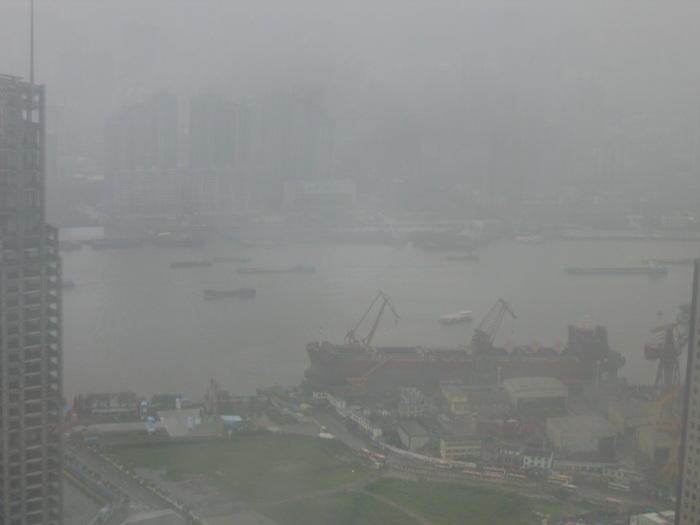 Air Pollution China - Shanghai Huangpu River and North Bund District (prior to reconsruction) from Grand Hyatt, Jin Mao Building, 73th floor, Pudong District.