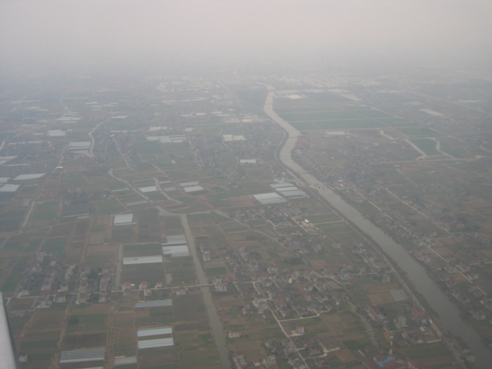 Air Pollution China - Shanghai Pudong Airport approach looking north