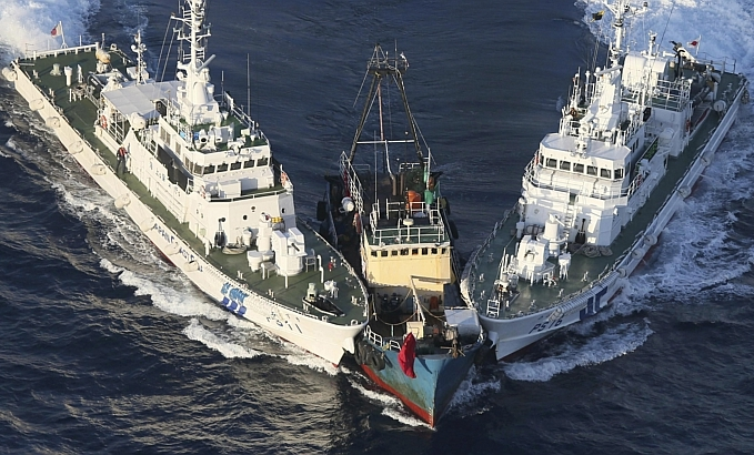 Two Japanese Coast Guard vessels, JCG Muzuki PS 11 and JCG Nobaru PS 16, colliding in the East China Sea, 15 August 2012 near the Senkaku Islands (Diaoyu, PRC)(Tiaoyutai, ROC) in an attempt to inhibit movement by a fishing vessel from Hong Kong